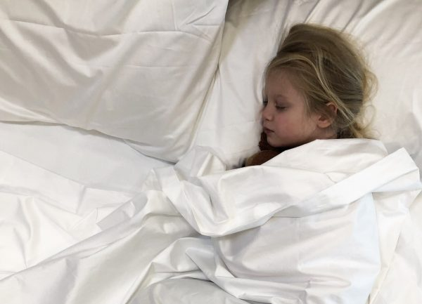 Child sleeping in a bed